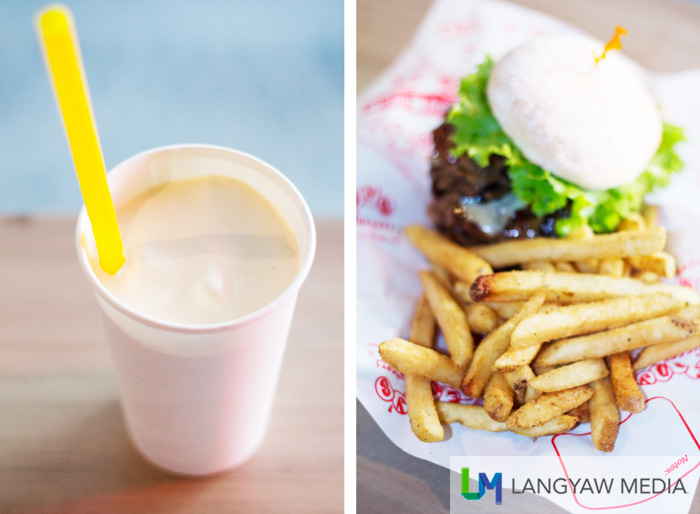 Left, thick peanut butter milk shake is 90% ice cream and 10% milk! Right, delicious garlic flavored fries