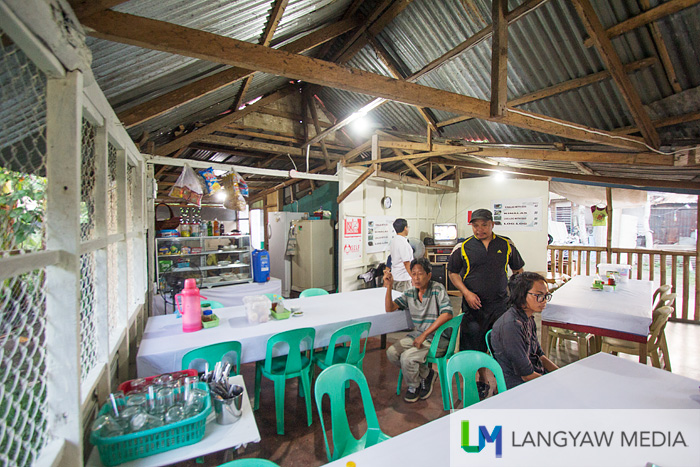 Inside the kinalasan, brightly lit and basic