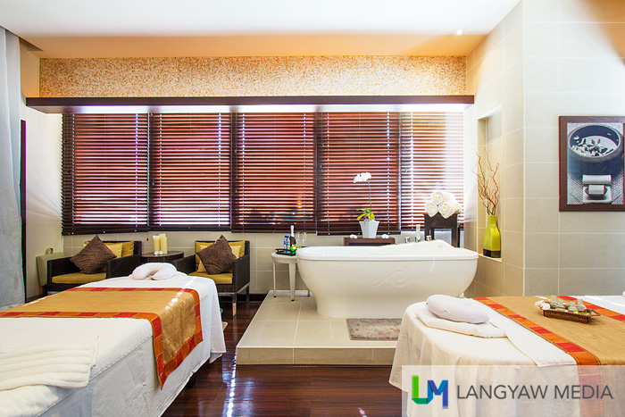 A spacious massage area that, with the blinds opened, provides a view of the garden