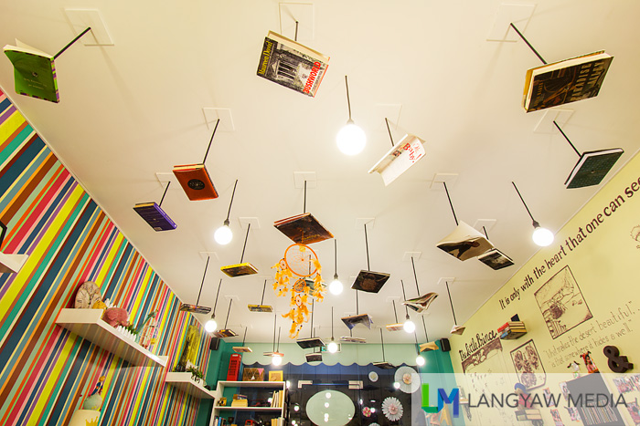 Books, punctured, screwed and hung at the ceiling