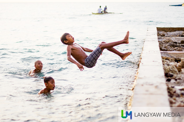 Boys playing at the small wharf