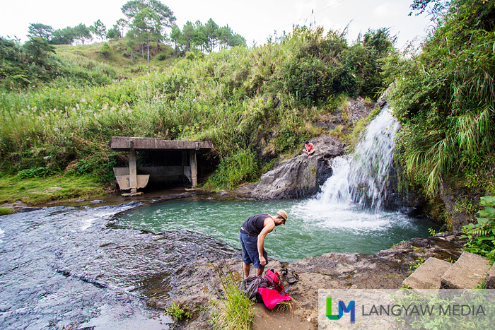 It's a small waterfall within cultivated land and just near the town proper of Sagada