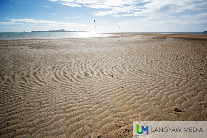 It's a wide beach that terminates into a sandbar at the end