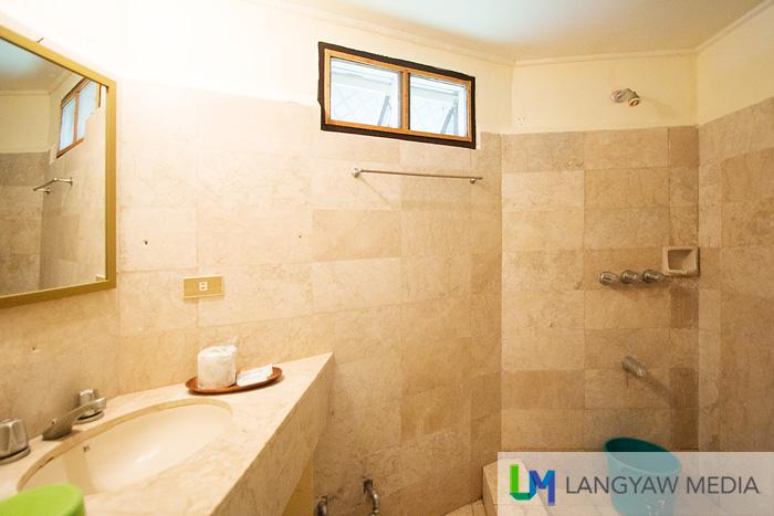 Marble tiled cabana bathroom and toilet