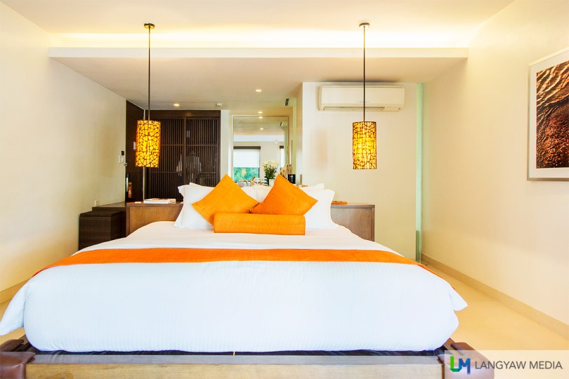 Comfortable king sized beds with those orange splash of color