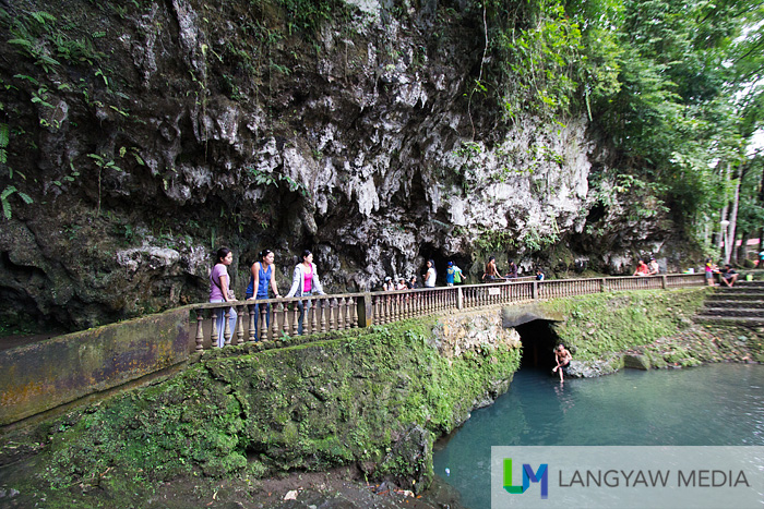 Pathway to Suhot Cave. The water below is cool and where visitors swim. It is spring fed.