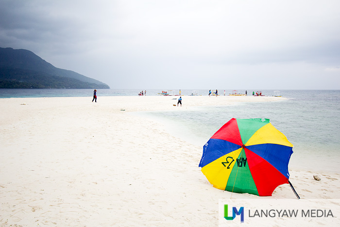 The popular multicolored parasol in White Island. It's also where most of these vendors get their sea urchin.
