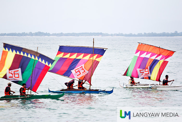 In the heat of the moment, vinta racers paddle a designated route