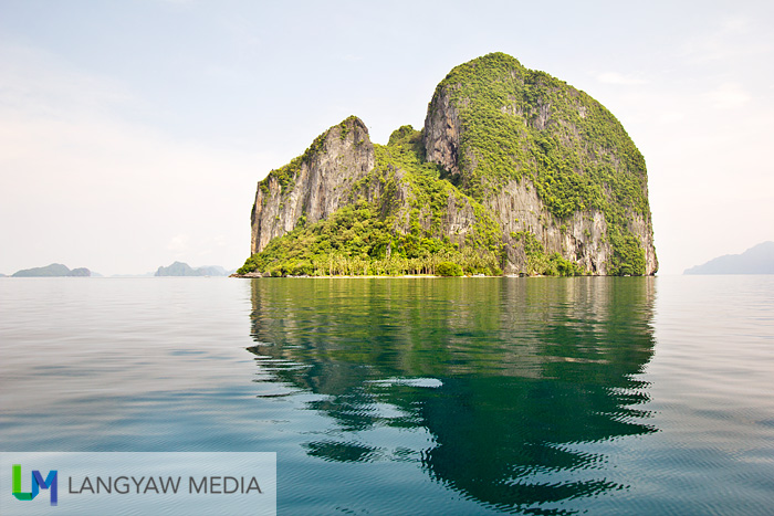 Pinagbuyutan Island as reflected on the sea's surface