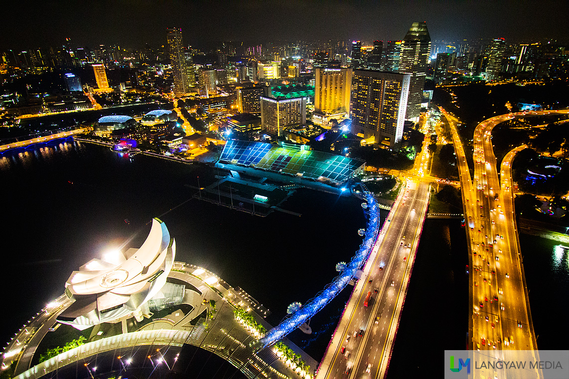 The beautiful city lights of Singapore as seen from the roofdeck of the Marina Bay Sands