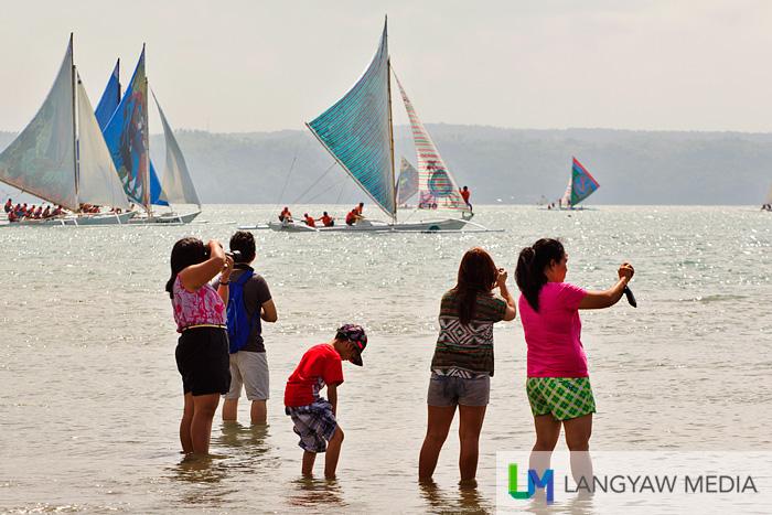 Regatta onlookers capturing the regatta with their cameras