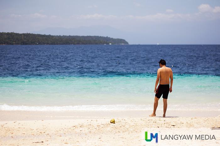 A beach goer checking out the shoreline