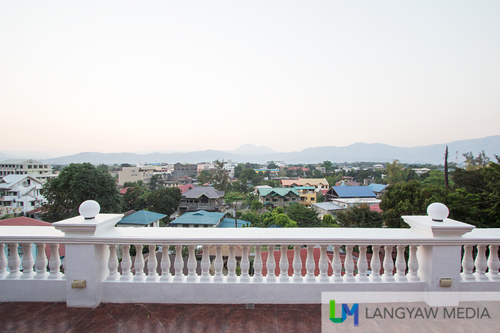Veranda overlooking the capital town of Bangued with the Sleeping Beauty mountain in the background
