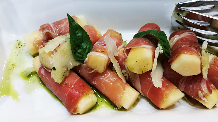 Prosciutto wrapped around slices of melon