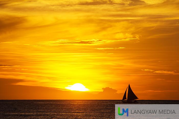 Paraw sailing at sunset