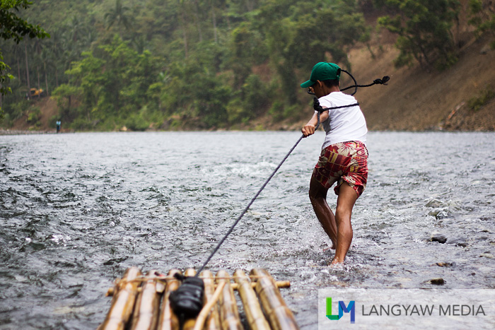 Braving the rough part of Timbaban River
