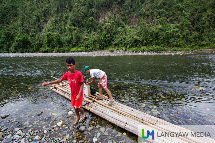 During school breaks and weekends, these children support their families by transporting people and goods up and down the Timbaban River through bamboo rafts like this one