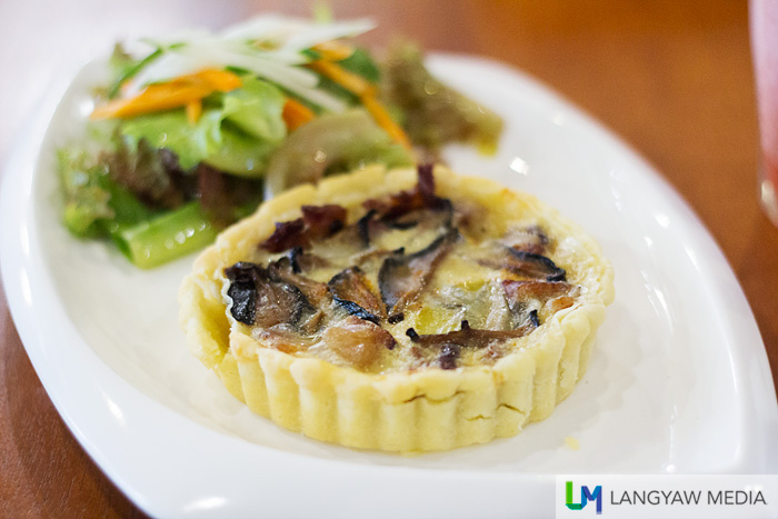 Bacon and mushroom quiche served with side salad