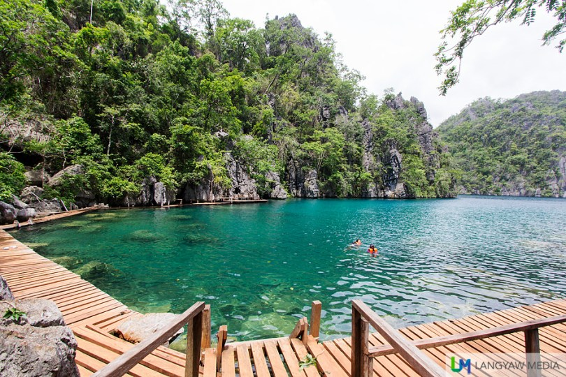 Pristine and cool waters of Kayangan Lake with wooden walkway