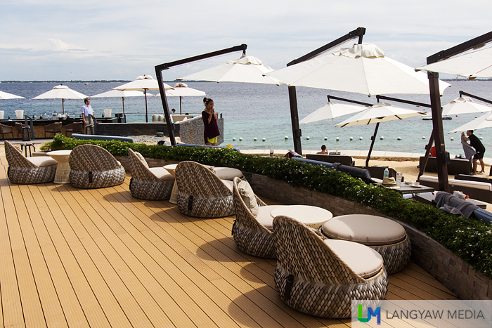 Beach lounging chairs and umbrellas