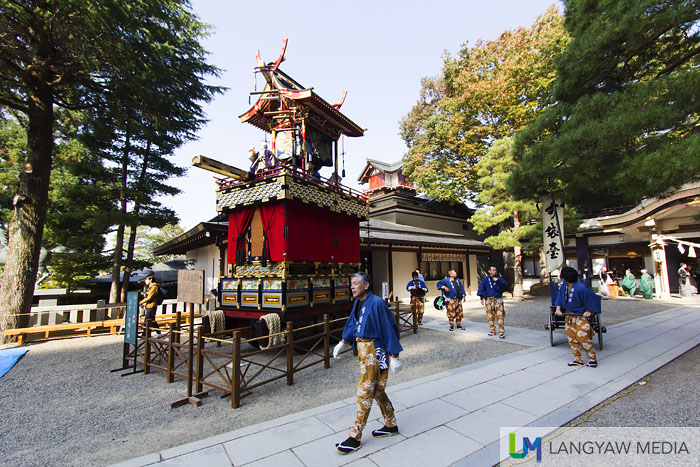 The Hoteitai yatai, one of eleven yatais or wooden processional carts with intricate woodwork and wonderful craftsmanship. The Hoteitai is placed at the square just below the shrine but separate from the rest of the yatais. It bears a puppet image of the priest Hotei and two others, a boy and a girl and are controlled through an intricate setup of strings. The puppets perform in the morning and afternoon of October 9 and 10.