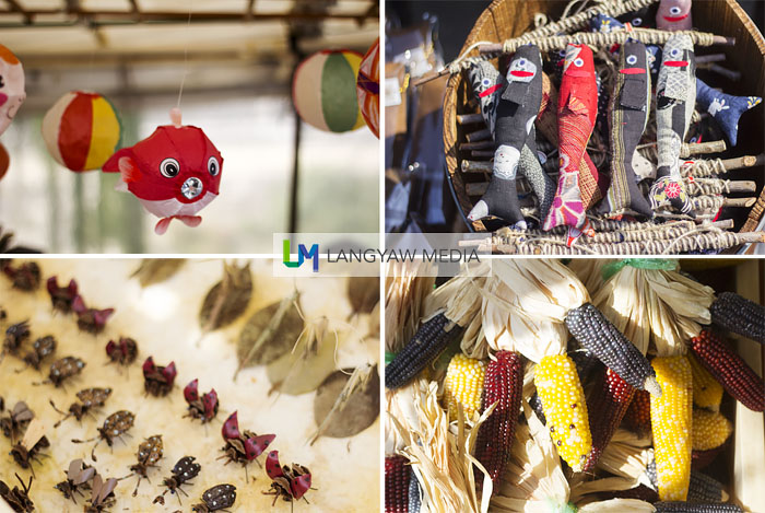 Quirky products that caught my attention, clockwise from top left: decorative stuffed fish, different kinds of corn, insect origami and paper balloons resembling fish