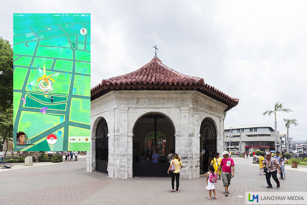 The Magellan's Cross Kiosk. Inset: Screencap of vicinity. The Kiosk marks the location of the gym.