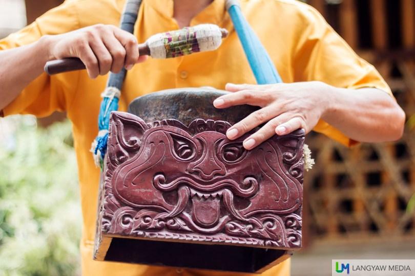 An ornate wooden gong holder