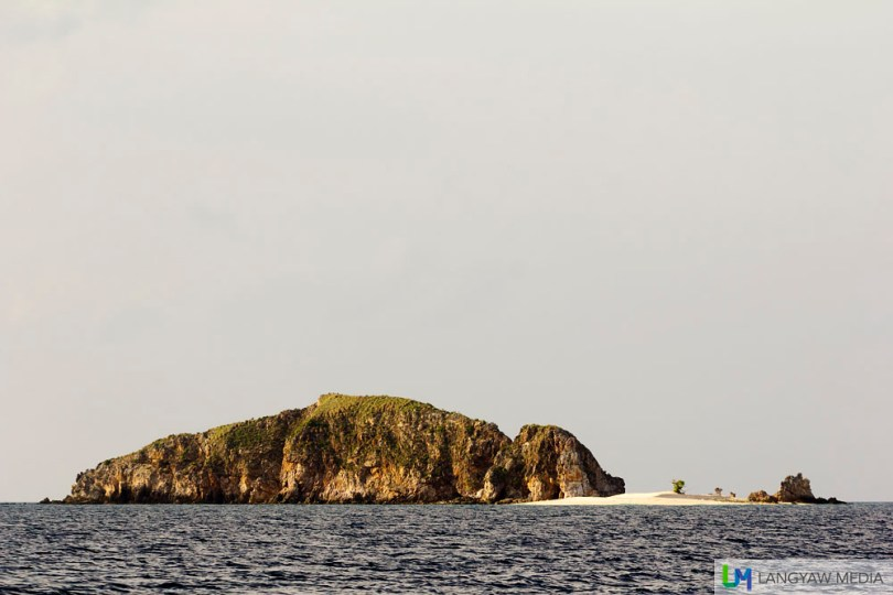 Malpagalen Islet with its white sand beach