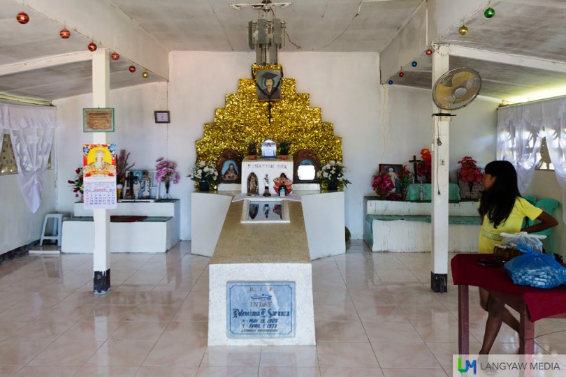 Inside this shrine is the semi corrupted remains of Inday Potenciana, with a glass topped tomb that enables you to see her darkened body.