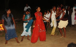 Tamil and Sinhala dancing around the fire