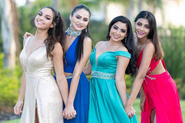 A group of teenage girls going to their prom dance