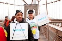 A Lantern resident and staff member walk over the Brooklyn Bridge together to support the NAMI walk for mental illness
