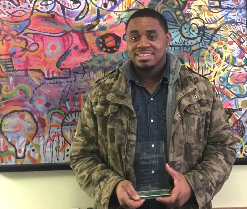 Lantern resident Roderick, with his youth achievement award from the Supportive Housing Network of New York