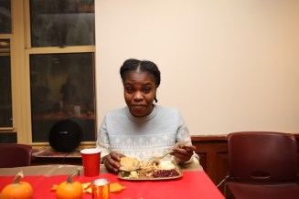 A Lantern tenant eats a Thanksgiving meal