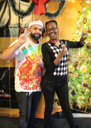 A young adult client poses with their Lantern Community Services case manager, at a holiday event in the Bronx