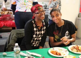 Young adults enjoy their holiday meal in the Bronx