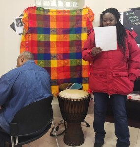 A resident takes part in the Black History Month Open Mic at Rustin House