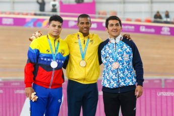 Lima, Sunday August 04, 2019 - Hersony Canelon from Venezuela, silver medal, Kevin Quintero from Colombia, gold medal, and Leandro Botasso from Argentina, bronze medal, during the Cycling Track Men´s Keirin Final Awards Ceremony at the Villa Deportiva Nacional - VIDENA at the Pan American Games Lima 2019. Copyright Miguel Bellido / Lima 2019 Mandatory credits: Lima 2019 ** NO SALES ** NO ARCHIVES **