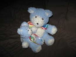 Baby blue bears, tiny and regular sizes.