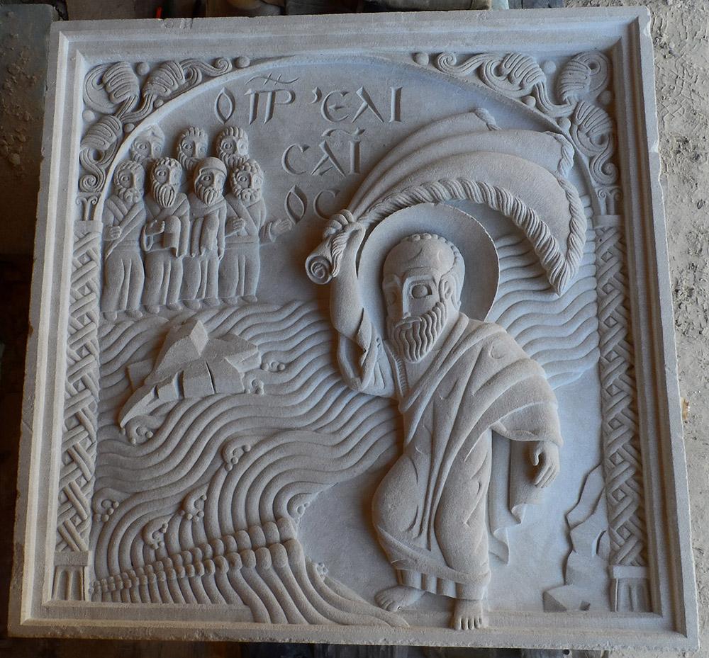 Moyen-relief sur lequel le prophète Elisée frappe le jourdain avec le manteau d'Elie. Les eaux commencent à se séparer sous le regard d'un groupe de prophètes de l'autre côté du fleuve.
