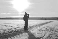 Standing on the frozen river