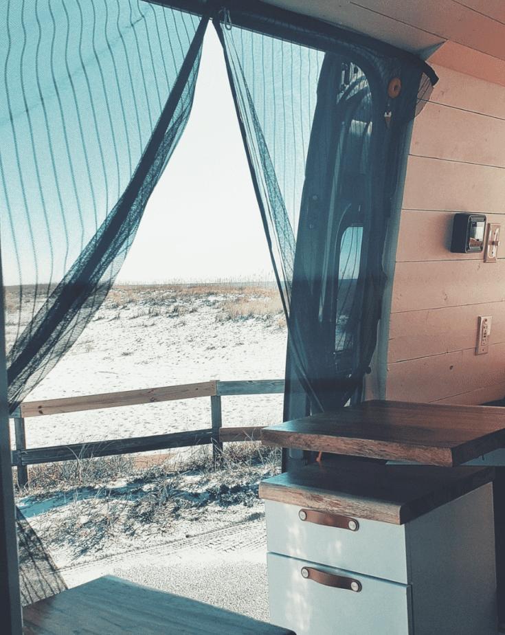 camper van conversion view of beach through sliders