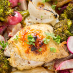 close up of oven roasted chicken thigh with parsley on top