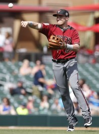 Mar 2, 2016; Salt River Pima-Maricopa, AZ, USA; Arizona Diamondbacks third baseman Brandon Drury (27) makes the off balance throw in the first inning during a spring training game against the Colorado Rockies at Salt River Fields at Talking Stick. Mandatory Credit: Rick Scuteri-USA TODAY Sports
