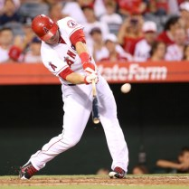 ANAHEIM, CA - SEPTEMBER 13: Mike Trout #27 of the Los Angeles Angels of Anaheim hits a solo home run in the third inning for his second home run of the game against the Houston Astros at Angel Stadium of Anaheim on September 13, 2014 in Anaheim, California. (Photo by Stephen Dunn/Getty Images)