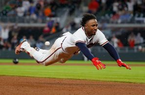 ATLANTA, GA - MAY 16: Ozzie Albies #1 of the Atlanta Braves dives safely for third base on his triple hit in the eighth inning against the Chicago Cubs at SunTrust Park on May 16, 2018 in Atlanta, Georgia. (Photo by Kevin C. Cox/Getty Images)