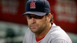 PHOENIX, AZ - AUGUST 26: Manager Mike Matheny #26 of the St Louis Cardinals looks on from the dugout during the first inning of a MLB game against the Arizona Diamondbacks at Chase Field on August 26, 2015 in Phoenix, Arizona. The Cardinals defeated the Diamondbacks 3-1. (Photo by Ralph Freso/Getty Images)