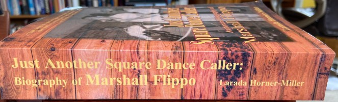 Thick book spine of Just Another Square Dance Caller: Authorized Biography of Marshall Flippo