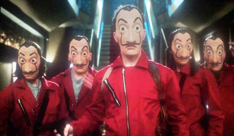 five dali masked people in red suits